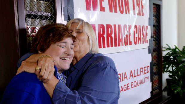 Same-sex couple Diane Olson (R) kisses her spouse Robin Tyler at attorney Gloria Allred's office reacting to Supreme Court's decision on same sex-marriage after a news conference on June 26th, 2015, in Los Angeles, California.