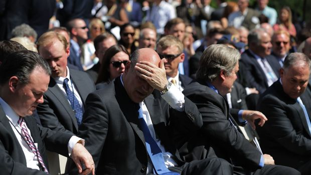 National Economic Council Director Gary Cohn wipes away sweat while waiting for President Donald Trump to announce his decision for the United States to pull out of the Paris Agreement on June 1st, 2017.