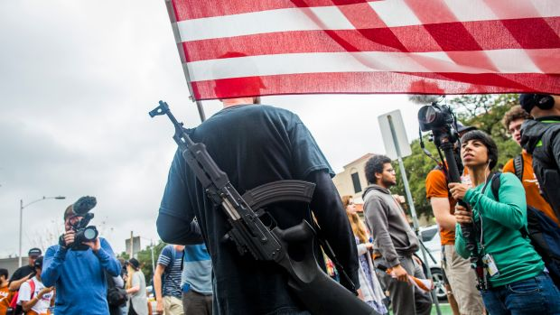 Gun activists march close to The University of Texas campus on December 12th, 2015, in Austin, Texas.