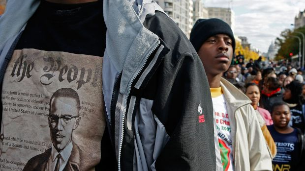 Lloyd Marshall (L) wears a Malcolm X shirt while participating in a march around the Department of Justice to protest hate crimes on November 16th, 2007, in Washington, D.C.