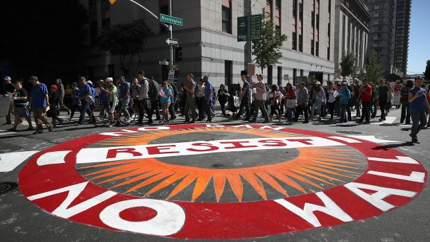 Protesters march during a May Day demonstration outside a U.S. Immigration and Customs Enforcement office in San Francisco, California, on May 1st, 2017.