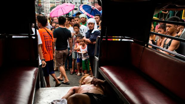 The body of an alleged drug dealer is seen inside a Jeepney after a large-scale anti-drug raid by the police at a slum community in Manila, the Philippines, on July 20th, 2017.