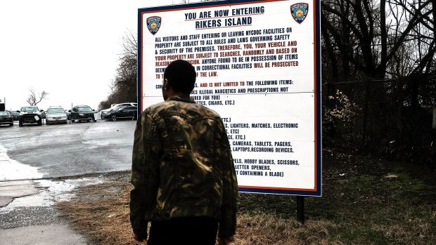 A man enters the road to Rikers Island on March 31st, 2017, in New York City.
