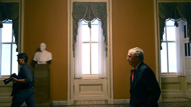 Senate Majority Leader Mitch McConnell walks to his office on July 26th, 2017, in Washington, D.C.
