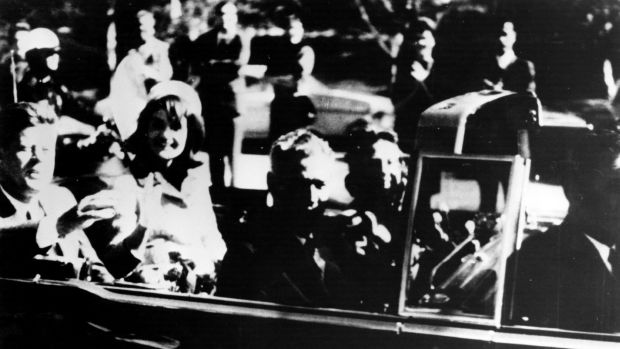 President John F. Kennedy and his wife Jacqueline ride with secret agents in an open car motorcade shortly before the president was assassinated in Dallas, Texas, on November 22nd, 1963.