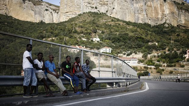 Migrants walk next to the Roya River on August 8th, 2017, in Ventimiglia, close to the French border.