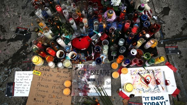 A growing memorial for Eric Garner near where he died after he was taken into police custody in Staten Island on July 22th, 2014, in New York City.