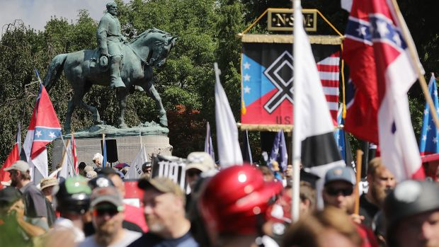 The statue of Robert E. Lee stands behind a crowd of hundreds of white nationalists, neo-Nazis, and members of the alt-right on August 12th, 2017, in Charlottesville, Virginia.