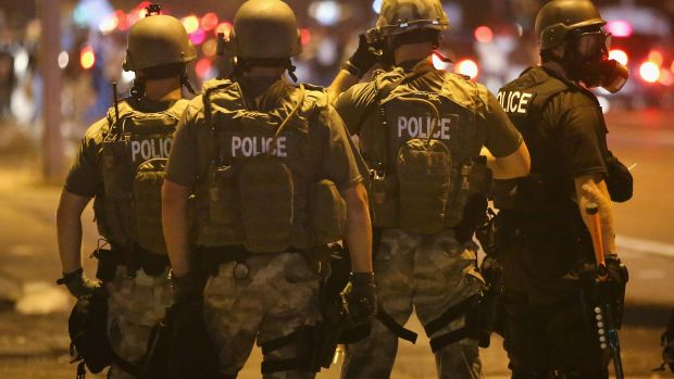 Police advance on demonstrators protesting on August 17th, 2014, in Ferguson, Missouri.