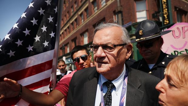 Maricopa County Sheriff Joe Arpaio is surrounded by protesters and members of the media at the site of the Republican National Convention on July 19th, 2016, in Cleveland, Ohio.
