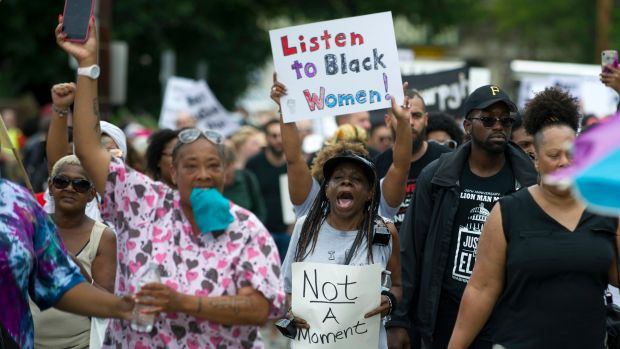 Marchers walk through the Homewood neighborhood during the Black Brilliance Collective: March and Gathering in Pittsburgh, Pennsylvania, on August 19th, 2017.
