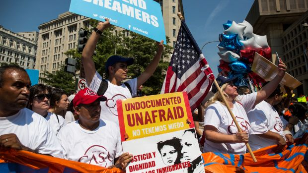 Demonstrators gather on Pennsylvania Avenue in response to the Trump administration's announcement that it would end the Deferred Action for Childhood Arrivals program on September 5th, 2017, in Washington, D.C.