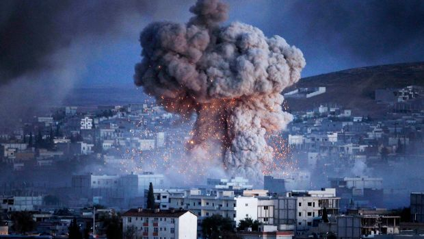 An explosion rocks Kobani, Syria, during a reported suicide car bomb attack by the ISIS militants on October 20th, 2014.