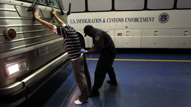 A man is searched while being in-processed at the Immigration and Customs Enforcement center on April 28th, 2010, in Phoenix, Arizona.