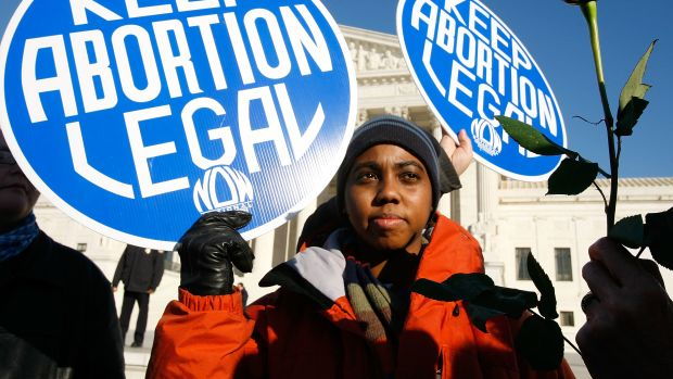 Pro-choice activists holds a sign in front of the U.S. Supreme Court on January 22nd, 2009, in Washington, D.C.
