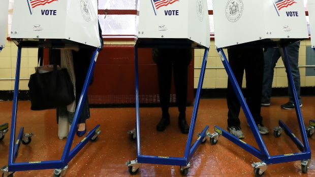 Voters cast their ballots at voting booths in New York City, New York.