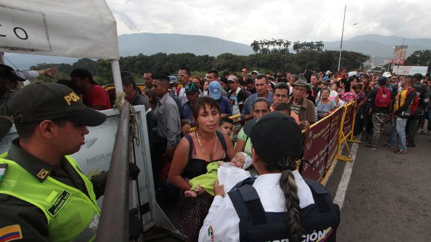 Venezuelan citizens cross the Simon Bolivar international bridge from San Antonio del Tachira in Venezuela to Norte de Santander province of Colombia on February 10th, 2018.