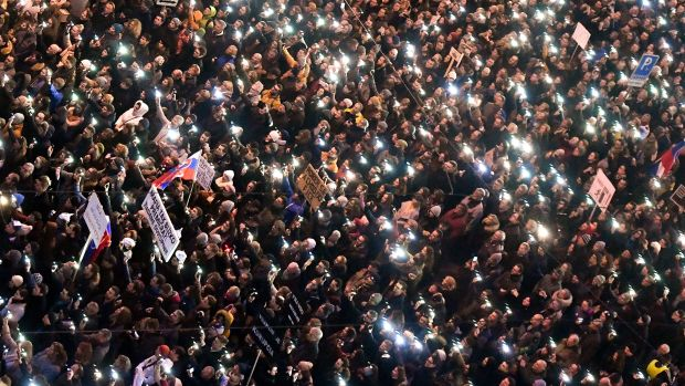 People gather near the Slovak National Uprising square on March 9th, 2018, during a rally against alleged political corruption, where they pay tribute to murdered Slovak journalist Jan Kuciak and his fiancee Martina Kusnirova in Bratislava, Slovakia.