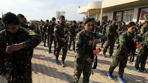 Members of the Kurdish People's Protection Units and Women's Protection Units attend the funeral of Kurdish fighters from the Syrian Democratic Forces that were killed in combat against the Islamic State.