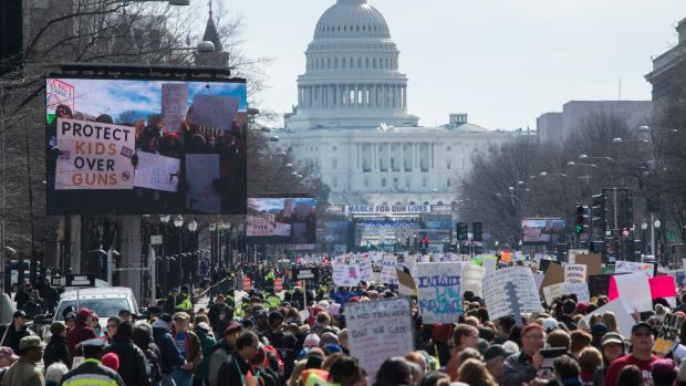 Participants take part in the March for Our Lives rally in Washington, D.C., on March 24th, 2018. Bundled against the cold but fired up with passion after a Florida high school massacre, crowds gathered in Washington on Saturday for what is expected to be the biggest U.S. gun control protest in a generation, with hundreds of thousands attending. The student-organized protest is to feature rallies from coast to coast, with the main event in Washington within sight of the U.S. Capitol, whose lawmakers the protesters hope to influence.