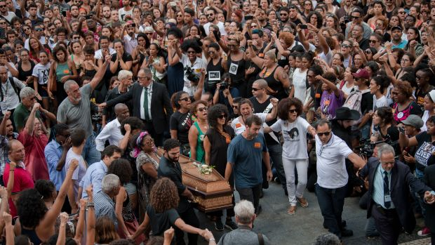 Politicians, friends, and relatives carry the coffin of slain Brazilian councilwoman and activist Marielle Franco during her funeral at Rio de Janeiro's Municipal Chamber in Brazil.