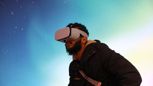 A man experiences Google's new Daydream View VR headset.