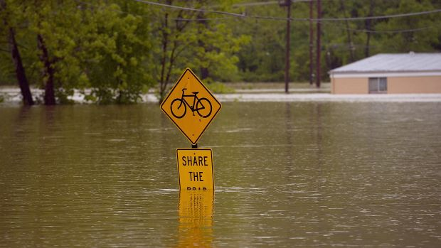 Floodwater covers a street sign on May 4th, 2017, in Fenton, Missouri.