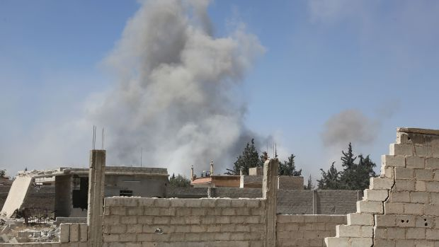 Smoke billows in the town of Douma on April 7th, 2018, after Syrian regime troops resumed a military blitz to pressure rebels to withdraw.