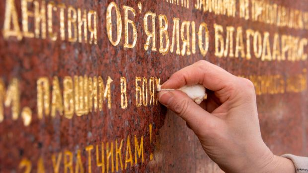 Martina Hoffinger of Arte Aurelia gilding company restores letters on the Soviet Memorial at Schwarzenberg square, in Vienna, Austria, on April 11th, 2018. The Soviet War Memorial was built to honor the soldiers of the Soviet army who died for the liberation of Austria from fascism.