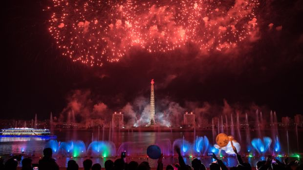 Spectators stand before a fireworks display over the Taedong River during celebrations marking the anniversary of the birth of late North Korean leader Kim Il Sung in Pyongyang, North Korea, on April 15th, 2018.