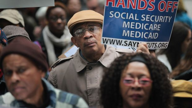 Demonstrators protest against cuts to federal safety net programs on November 7th, 2011, in Chicago, Illinois.