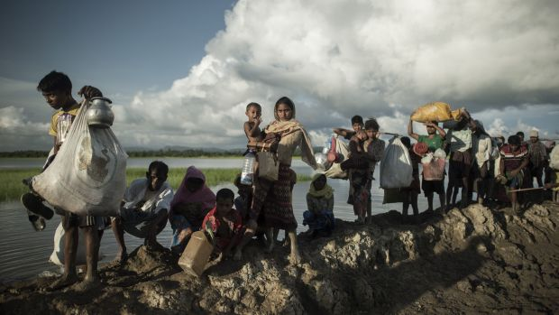 Rohingya refugees walk after crossing the Naf river from Myanmar into Bangladesh.