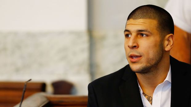 Aaron Hernandez sits in the courtroom of the Attleboro District Court during his hearing on August 22nd, 2013, in North Attleboro, Massachusetts.