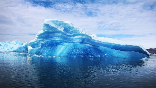 Calved icebergs from the nearby Twin Glaciers are seen floating on the water in Qaqortoq, Greenland.