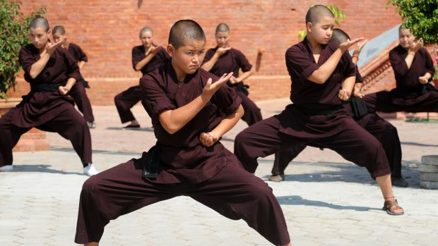Buddhist nuns practice kung fu at the Amitabha Drukpa Nunnery on the outskirts of Kathmandu, Nepal.