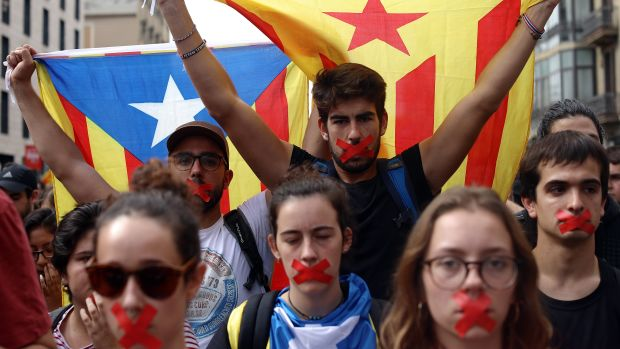 Students hold a silent protest against the violence that marred Catalonia's referendum vote on October 2nd, 2017, in Barcelona, Spain.