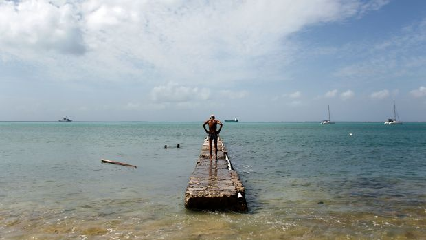A man stands on a damage pier days after this Caribbean island sustained extensive damage in the wake of Hurricane Irma on September 15th, 2017, in St. Martin.
