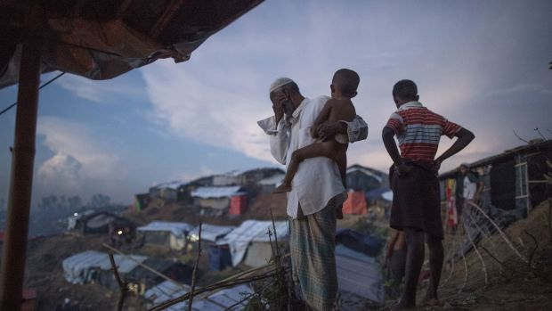 Rohingya Muslim refugees look at the hundreds of tents filling a refugee camp in Bangladesh's Ukhiya district on October 4th, 2017.
