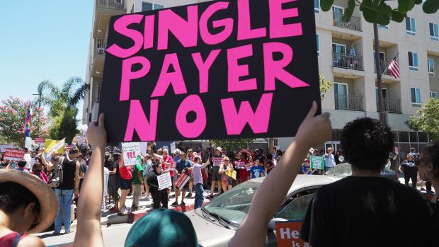 People rally in favor of single-payer health care outside of the office of Speaker of the California State Assembly Anthony Rendon on June 27th, 2017, in South Gate, California.