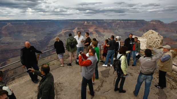 Tourists snap photos at Mather Point in the Grand Canyon National Park, Arizona.