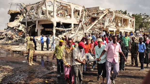 Somali men carry the body of a victim who died in the explosion of a truck bomb in the center of Mogadishu, on October 15th, 2017.