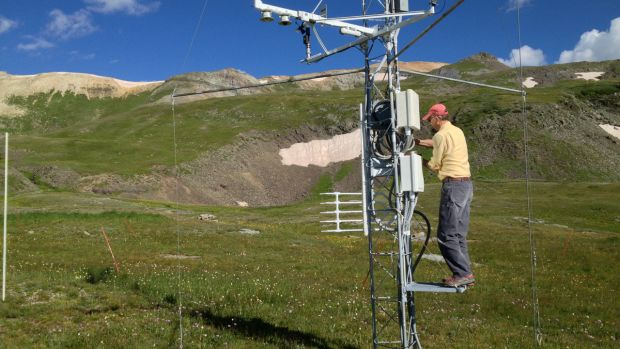 Mountain researcher Chris Landry, former director of the Colorado Center for Snow and Avalanche Studies, checks climate measuring instruments at a research station at 11,000 feet elevation in the San Juan Mountains of Colorado.