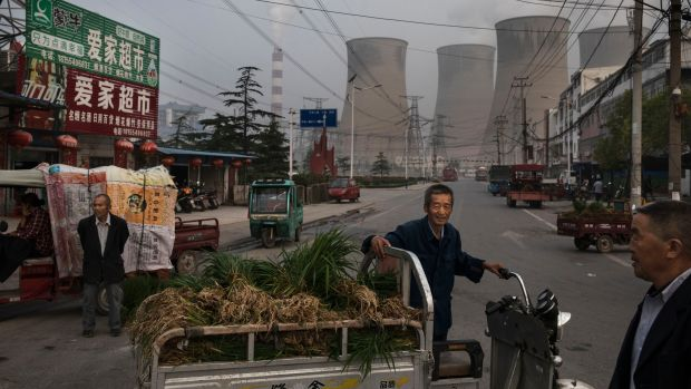 Chinese street vendors at a market outside a state-owned coal-fired power plant near the site of a large floating solar farm construction project on June 14th, 2017, in Huainan, Anhui province, China.