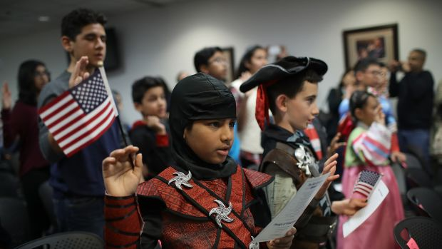 Dressed as a ninja, Shaheer Sarwar from Pakistan takes the oath of United States citizenship during a Halloween-themed citizenship ceremony on October 31st, 2017, in Fairfax, Virginia.