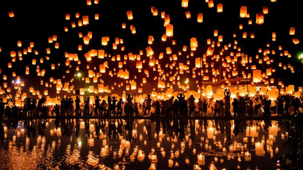 A crowd releases lanterns into the air to celebrate the Yee Peng festival, also known as the Festival of Lights, in the city of Chiang Mai in Northern Thailand on November 3rd, 2017.