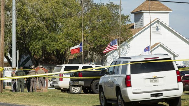 Law enforcement officials gather near the First Baptist Church following a shooting on November 5th, 2017, in Sutherland Springs, Texas.
