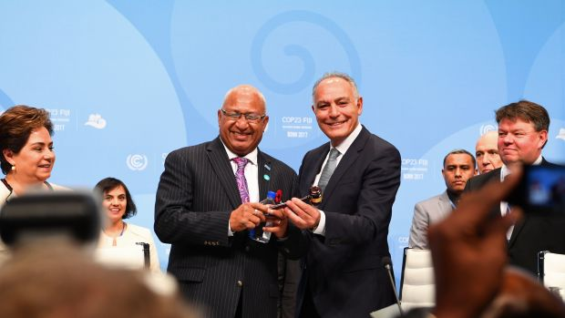 Salaheddine Mezouar (right), Moroccan foreign minister and president of COP22, hands over a symbolic hammer to Frank Bainimarama (left), prime minister of Fiji and president of COP23, during the opening session of the COP23 United Nations Climate Change Conference on November 6th, 2017, in Bonn, Germany.