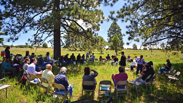 Convening Tribes gather below the Bears Ears buttes.