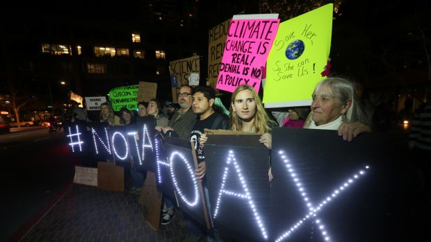 Protesters display signs during a rally against climate skepticism in San Diego, California, on February 21st, 2017.
