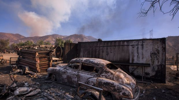 A burned classic car is seen in Little Tujunga Canyon during the Creek Fire on December 6th, 2017, near Sylmar, California.